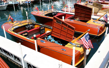Row of classic wooden boats with blonde accents. Splash this on your bar.